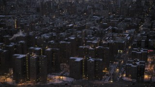 AX66_0359 - 5K stock footage aerial video flyby East Village apartment buildings in winter, New York City, twilight