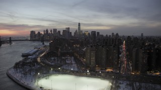 AX66_0361 - 5K stock footage aerial video of Lower East Side and Lower Manhattan skyline in winter, New York City, twilight