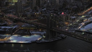 AX66_0369 - 5K stock footage aerial video of orbiting Brooklyn Bridge in winter, New York City, twilight