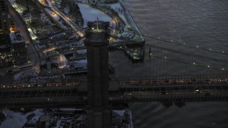 AX66_0370 - 5K stock footage aerial video orbit Brooklyn Bridge in winter, New York City, twilight
