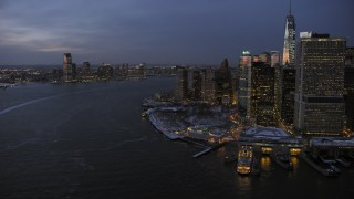 AX66_0374 - 5K stock footage aerial video of Lower Manhattan and Jersey City in winter, New York City, twilight