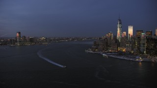 AX66_0375 - 5K stock footage aerial video of Downtown Jersey City and Lower Manhattan in winter, New York City, twilight