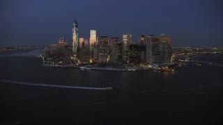 AX66_0376 - 5K stock footage aerial video of Lower Manhattan skyline in winter, New York City, twilight