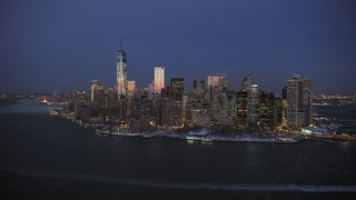 AX66_0377 - 5K stock footage aerial video of the Lower Manhattan skyline and Battery Park in winter, New York City, twilight