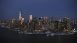 AX66_0378 - 5K stock footage aerial video of One World Trade Center and Lower Manhattan in winter, New York City, twilight