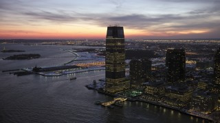 AX66_0383 - 5K stock footage aerial video of Goldman Sachs Tower in Jersey City in winter, New Jersey, twilight