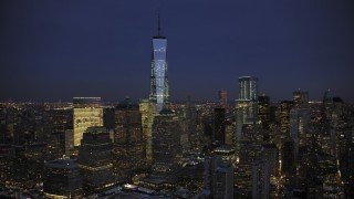AX66_0386 - 5K stock footage aerial video approach One World Trade Center in winter, New York City, twilight
