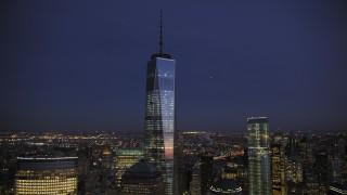 AX66_0387 - 5K stock footage aerial video orbit One World Trade Center in winter, New York City, twilight