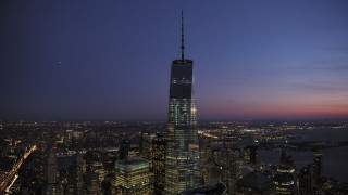 AX66_0388 - 5K stock footage aerial video of an orbit of One World Trade Center in winter, New York City, twilight