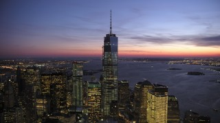 AX66_0389 - 5K stock footage aerial video orbit away from the One World Trade Center in winter, New York City, twilight