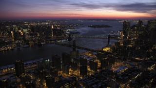 AX66_0393 - 5K stock footage aerial video of Manhattan and Brooklyn Bridges in winter, New York City, twilight