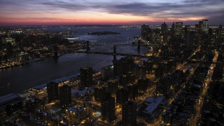 AX66_0394 - 5K stock footage aerial video of Manhattan and Brooklyn Bridges in winter, New York City, twilight