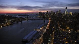 AX66_0396 - 5K stock footage aerial video of Manhattan and Bridge Brooklyn Bridges and Lower Manhattan Skyline in winter, New York City, twilight