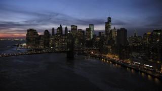AX66_0400 - 5K stock footage aerial video approach Brooklyn Bridge and Lower Manhattan skyline, New York City, twilight