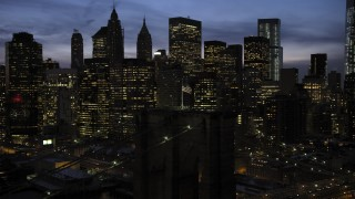 AX66_0402 - 5K stock footage aerial video of Brooklyn Bridge and Lower Manhattan skyline in winter, New York City, twilight