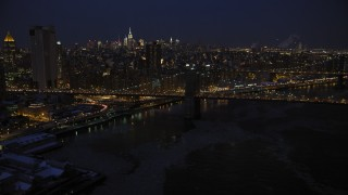 AX66_0404 - 5K stock footage aerial video approach Brooklyn Bridge in winter, New York City, night