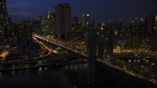 AX66_0405 - 5K stock footage aerial video of the Brooklyn Bridge in winter, New York City, night