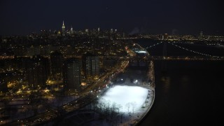 AX66_0409 - 5K stock footage aerial video of Lower East Side and Williamsburg Bridge in winter, New York City, night