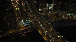 AX66_0422 - 5K stock footage aerial video of Queensboro Bridge and Midtown Manhattan skyscrapers, New York City, night