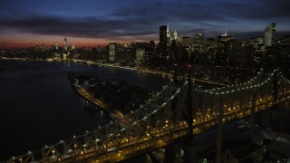 AX66_0424 - 5K stock footage aerial video fly over Queensboro Bridge toward Midtown Manhattan skyscrapers, New York City, night
