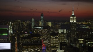 AX66_0430 - 5K stock footage aerial video of Lower Manhattan skyscrapers behind Chrysler and Empire State Building, New York City, night