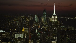 AX66_0437 - 5K stock footage aerial video of Empire State Building and Lower Manhattan skyscrapers, New York City, night