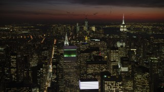 AX66_0438 - 5K stock footage aerial video of Empire State and Chrysler Buildings, and Lower Manhattan, New York City, night