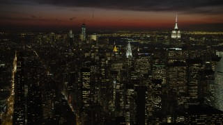 AX66_0439 - 5K stock footage aerial video of Empire State and Chrysler Building with view of Lower Manhattan skyscrapers, New York City, night