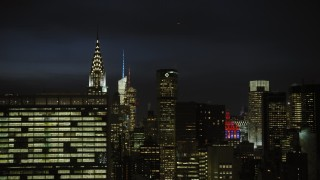 AX66_0443 - 5K stock footage aerial video of Chrysler Building in Midtown Manhattan, New York City, night