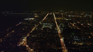 AX67_0005 - Aerial stock footage of 4K stock video aerial view of orbiting campus at Columbia University at night, New York City, New York