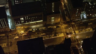 AX67_0010 - Aerial stock footage of 4K stock video aerial view of cars on Broadway by Columbia University at night, New York City, New York