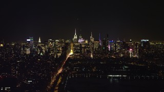 AX67_0012 - Aerial stock footage of 4K stock video aerial view of a view of the Midtown Manhattan skyline at night, New York City, New York