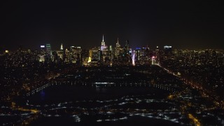 AX67_0014 - Aerial stock footage of 4K stock video aerial view of Midtown Manhattan and Central Park reservoir at night in winter, New York City, New York