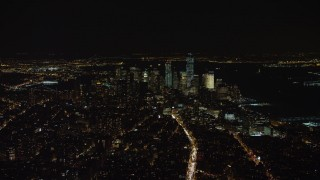 AX67_0022 - Aerial stock footage of 4K stock video aerial view of Lower Manhattan skyline at night in New York City, New York