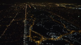 AX67_0025 - Aerial stock footage of 4K stock video aerial view of lit pathways through Central Park in winter at night, New York City, New York