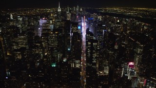 AX67_0027 - Aerial stock footage of 4K stock video aerial view follow 7th Avenue to approach Times Square at night, Midtown Manhattan, New York City, New York