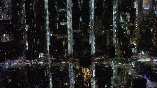 AX67_0030 - Aerial stock footage of 4K stock video aerial view of bird's eye view of city streets in Midtown Manhattan at night, New York City, New York