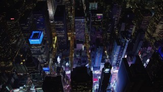 AX67_0032 - Aerial stock footage of 4K stock video aerial view tilt to the bright lights of Times Square at night, Midtown Manhattan, New York City, New York