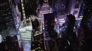 AX67_0034 - Aerial stock footage of 4K stock video aerial view of Times Square and Midtown skyscrapers at night, New York City, New York