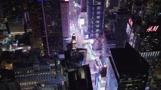 AX67_0035 - Aerial stock footage of 4K stock video aerial view orbit Times Square and skyscrapers at night in Midtown Manhattan, New York City, New York