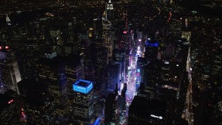 AX67_0036 - Aerial stock footage of 4K stock video aerial view tilt from Times Square to reveal Empire State Building at night, Midtown Manhattan, New York City, New York