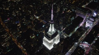 AX67_0039 - Aerial stock footage of 4K stock video aerial view approach the Empire State Building at night, Midtown Manhattan, New York City, New York