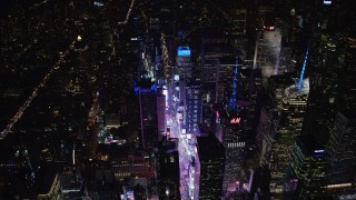AX67_0040 - Aerial stock footage of 4K stock video aerial view flyby Times Square and skyscrapers at night, Midtown Manhattan, New York City, New York