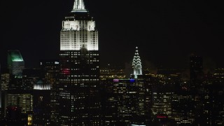 AX67_0050 - Aerial stock footage of 4K stock video aerial view flyby the Empire State Building and Chrysler Building at night, Midtown Manhattan, New York City, New York