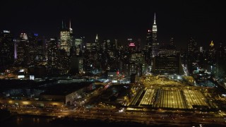 AX67_0053 - Aerial stock footage of 4K stock video aerial view of passing Hudson Yards and Hell's Kitchen skyscrapers at night, Midtown Manhattan, New York City
