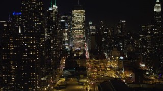 AX67_0054 - Aerial stock footage of 4K stock video aerial view of skyscrapers in the Hell's Kitchen area at night, Midtown Manhattan, New York City