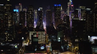AX67_0055 - Aerial stock footage of 4K stock video aerial view of flying by Hell's Kitchen skyscrapers at night, Midtown Manhattan, New York City, New York