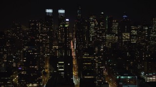 AX67_0056 - Aerial stock footage of 4K stock video aerial view of flying by Hell's Kitchen and Upper West Side at night, New York