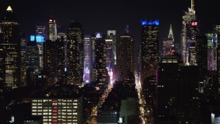 AX67_0059 - Aerial stock footage of 4K stock video aerial view of flying by Hell's Kitchen area of Midtown Manhattan at night, New York