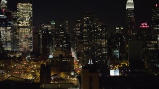 AX67_0060 - Aerial stock footage of 4K stock video aerial view of passing Hell's Kitchen area of Midtown Manhattan at night, New York
